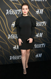 Katherine Langford completed her low-key look with a black velvet clutch by Jimmy Choo.