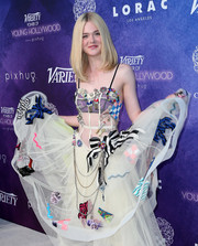 Elle Fanning added a dose of eclectic style to her look with a sheer-paneled Marc Jacobs dress that boasted decorative embellishments and a delicate bodice.