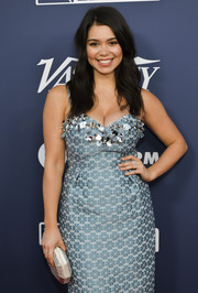 Auli'i Cravalho paired a studded silver clutch with a blue floral dress for the Variety Power of Young Hollywood event.