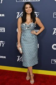 Auli'i Cravalho polished off her look with a pair of silver triple-strap sandals.
