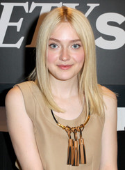 Dakota Fanning wore her hair sleek straight with a center part when she visited the Variety Studio.