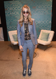 Cara Delevingne layered a slate-blue pantsuit over a see-through lace top for her visit to the Variety Studio.