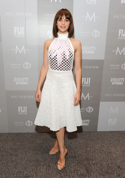 Felicity Jones opted for sleek ankle-strap sandals to complete her outfit.