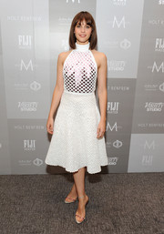 Felicity Jones visited the Variety Studio wearing a white mesh-overlay halter top by Christian Dior.