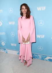 Abigail Spencer drowned her slim figure in a long-sleeve pink maxi dress by Solace London at the Variety and Women in Film pre-Emmy celebration.