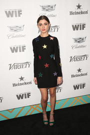 Natalia Dyer looked adorable at the Variety and Women in Film pre-Emmy celebration in a black Valentino mini dress adorned with multicolored sequin stars.