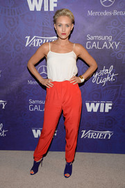 Nicky Whelan's purple cutout booties contrasted nicely with her red pants.