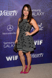 Shanelle Workman teamed her monochrome dress with pink pumps for a pop of feminine color.