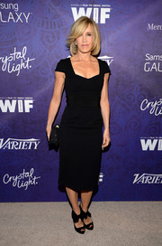Felicity Huffman pulled her outfit together with a pair of black ankle-tie peep-toes.