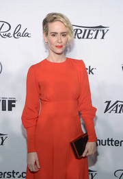 Sarah Paulson attended the Variety and Women in Film pre-Emmy celebration carrying a black box clutch by Naeem Khan.
