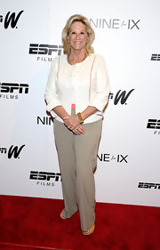 Donna opted for lighter colors on the red carpet when she wore this cream blazer over a white top.