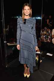 Helena Bordon donned a stud and mirror-embellished asymmetrical gray dress by Tory Burch for the Vera Wang fashion show.
