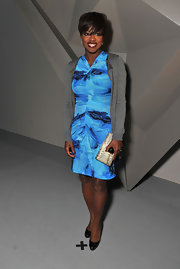 Viola Davis dressed down her blue watercolor dress with an unassuming charcoal cardigan.