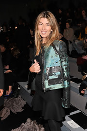 Nina Garcia looked seriously chic at the Vera Wang Fall 2013 fashion show in a silk and leather zip-up jacket.