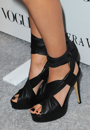 The actress wore a fabulous pair of black leather, ankle-wrapped platforms with black toe polish.