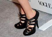 Amber Valletta stole the show in her lace-up pumps while attending the Vera Wang store launch. Her shoes were so eye-catching it was hard to pay attention to what she was actually wearing.