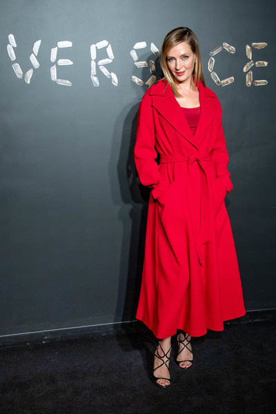 Uma Thurman arrived for the Versace Pre-Fall 2019 show wearing a belted scarlet coat.