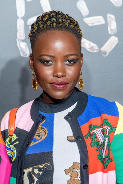 Lupita Nyong'o looked cool with her multi-braid 'do at the Versace Pre-Fall 2019 show.