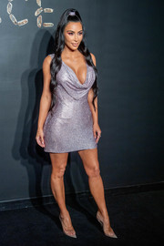 Kim Kardashian attended the Versace Pre-Fall 2019 show looking sexy (as always) in a draped lavender chainmail dress.