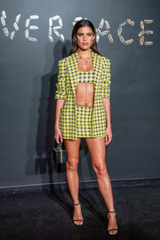Sara Sampaio flashed plenty of skin in a skimpy yellow skirt suit by Versace during the brand's Pre-Fall 2019 show.