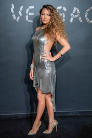 Blake Lively sizzled in a silver chainmail halter dress by Versace during the brand's Pre-Fall 2019 show.