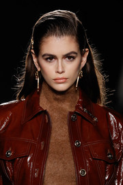 Kaia Gerber sported a straight hairstyle with pinned sides at the Versace runway show.