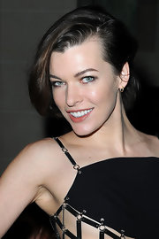 Milla swept her short hair to the side for this chic half-up 'do.