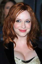 Christina Hendricks wore her famous red locks in crunched waves front row at the Versace fashion show.