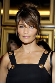 Helena Christensen wore her shiny locks in a cute, casual updo at the Versace for H&M fashion event.
