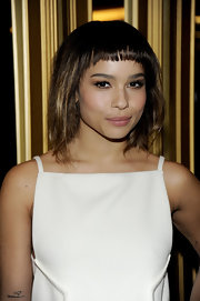 Zoe Kravitz wore her adorable pageboy slightly tousled at the Versace for H&M fashion event.