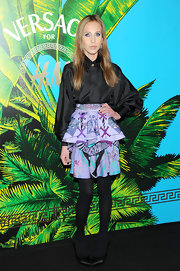 Allegra Versace topped off her look with classic black satin pumps.