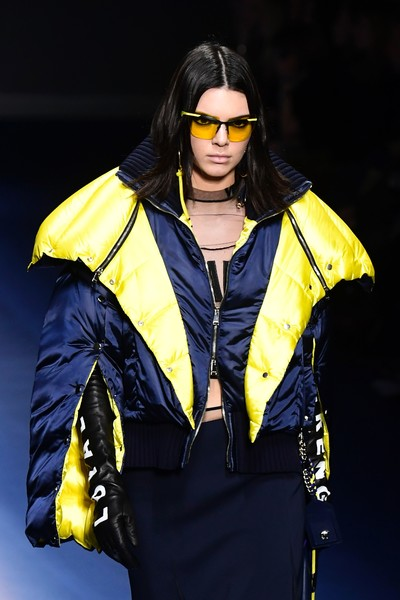 Kendall Jenner swept down the Versace runway looking sporty in yellow shield sunglasses and a padded jacket.