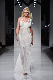 Lara Stone was sporty-glam in this multitextured white cutout gown during the Atelier Versace fashion show.