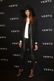 Chanel Iman opted for a bohemain look at the Constellation launch in a crisp black blazer and a long wispy scarf.
