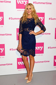 Stephanie Pratt styled her frock with a beaded Union Jack clutch by Alexander McQueen.