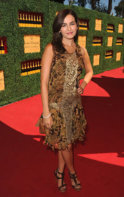 At the Veuve Clicquot soiree, Camilla Belle paired her floral print frock with brown leather wedges.