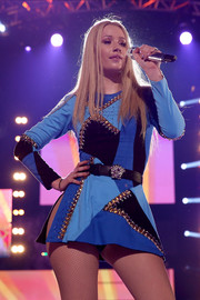 Iggy Azalea looked provocative in a crotch-revealing mini dress with spiky detailing during her SuperFanFest performance.