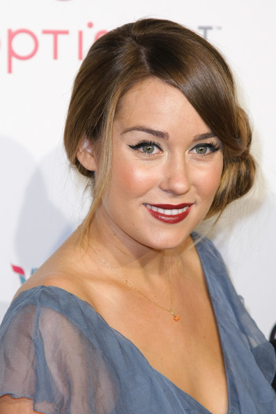 Lauren Conrad looked like an Old-Hollywood starlet at the VH1 Save the Music Gala. The reality star paired her loose bun with deep red lipstick.