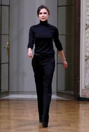 Victoria Beckham paired her sweater with basic black trousers.