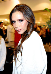 Victoria Beckham visited Selfridges wearing her long locks in a gently wavy side sweep.