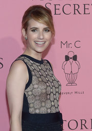 Emma Roberts looked adorable at Victoria's Secret What Is Sexy? party wearing her hair in a girly retro-inspired updo.