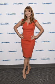 Jane Seymour visited SiriusXM wearing a classic orange sheath dress.