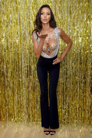 Lais Ribeiro wore her silver wrap top open at the front to reveal her Champagne Nights Fantasy Bra.