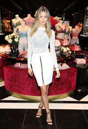 Martha Hunt oozed sex appeal even without showing much skin in this semi-sheer white sweater while launching the Easy Collection from Body by Victoria.