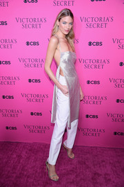 Martha Hunt sizzled in a long silver camisole with split sides at the 2017 Victoria's Secret fashion show viewing party.