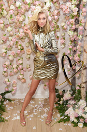 Elsa Hosk matched her dress with a pair of gold ankle-strap heels.