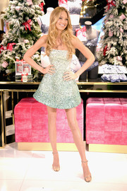 Romee Strijd  looked appropriately festive in a strapless mini dress rendered entirely in mint-green sequins while celebrating the Victoria's Secret fashion show at the new 5th Avenue store.