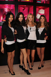 Chanel Iman donned classic black patent Christian Louboutin pumps while posing with her fellow V.S. models.
