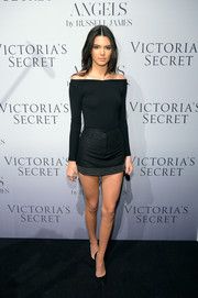 Kendall Jenner showed off miles of leg in a black micro mini with a grommeted hem.