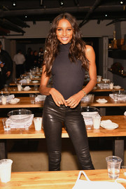 Jasmine Tookes matched a sleeveless black turtleneck with leather skinnies for the Victoria's Secret Influencer Pizza-Making Class.